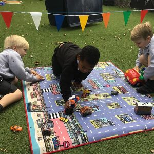 Schoolchildren Playing on their Educational Toy - a Brighton Car Play Mat at School! - Best Kids Toy 2021